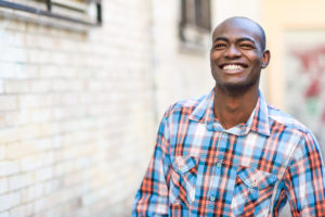 man smiling with perfectly white teeth