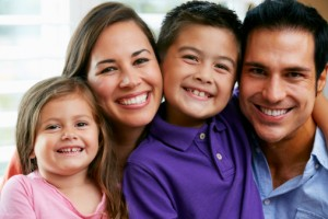 Happy family with beautiful smiles thanks to the dentist medina families trust