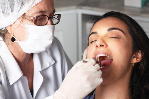 Woman receives essential oral cancer screening Medina, OH trusts