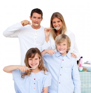 Merry Entire Smiling Family Brushing Their Teeth