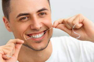 Brushing partners with flossing. Dr. Allan J. Milewski, dentist in Medina, tells patients to floss daily to optimize oral health.
